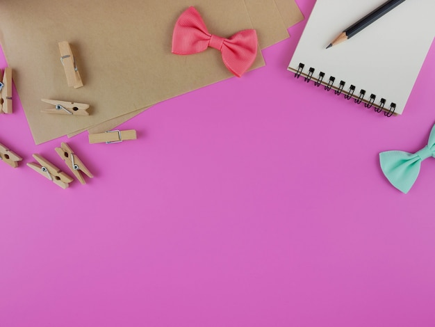 Pink desk with craft tools and copy space Premium Photo