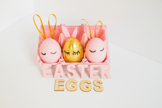 Pink Easter eggs with bunny ears Free Photo
