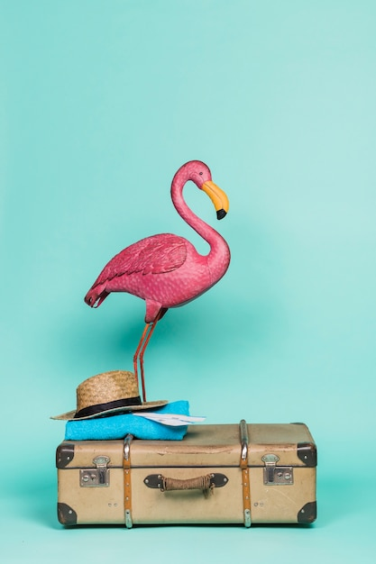 Pink flamingo on travel accessories Free Photo