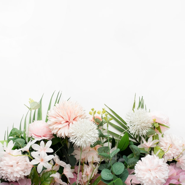 Pink flower border with palm leaves on white background Free Photo