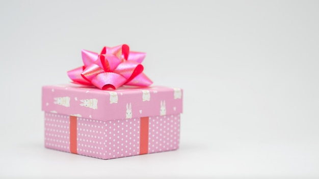 Pink gift box with pink ribbon on a white background congratulations on various occasions - pictures Premium Photo