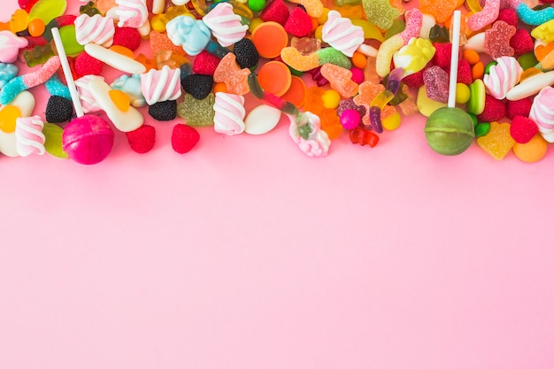 Pink and green lollipops on gummies Free Photo