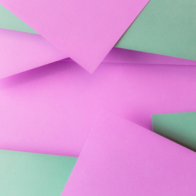 Pink and green paper and copyspace for writing the text Free Photo