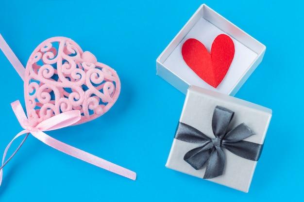 Pink heart on blue background Premium Photo