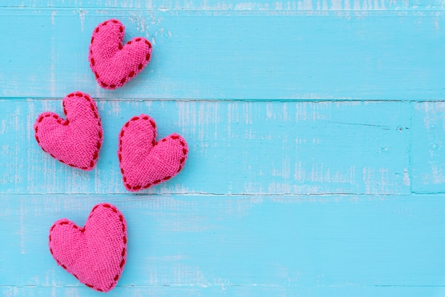 Pink heart on blue and white color wooden background, love, wedding and valentines day Premium Photo