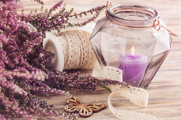 Pink heather, purple candle pot, butterfly Premium Photo