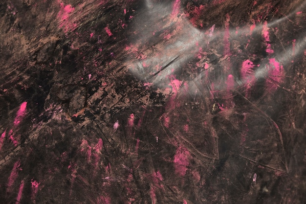 Pink holi color on the black textured wooden backdrop Free Photo