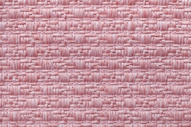 Pink knitted woolen background with a pattern of soft Premium Photo