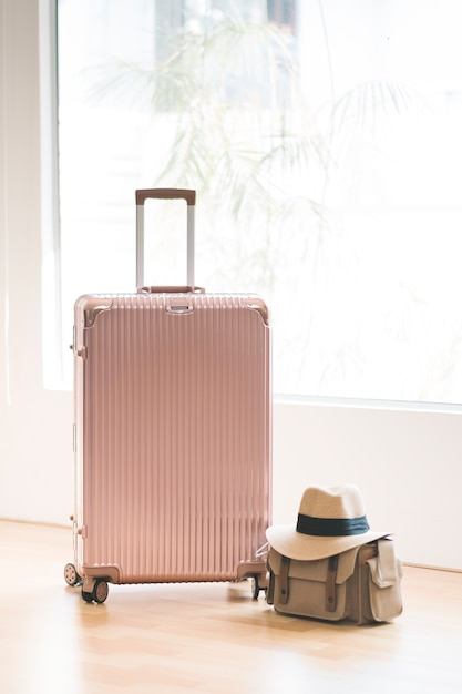 Pink luggage and bag and hat for travel Free Photo