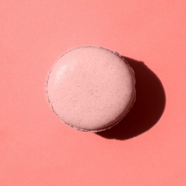 Pink macaroon on coral background Free Photo