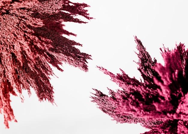 Pink magnetic metallic shaving on the corner of white background Free Photo
