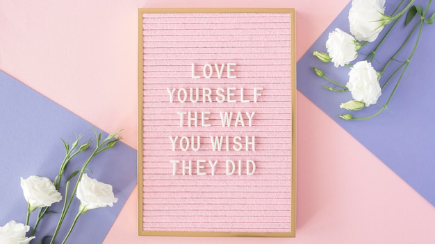 Pink motivational text board above view Free Photo