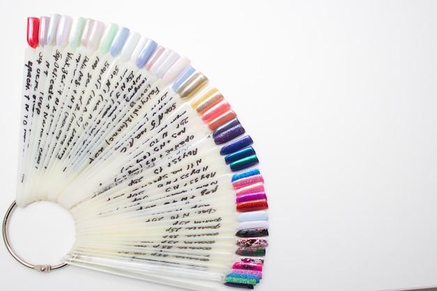 Pink multicolor nail polish palette for client's nails choise. copyspace Premium Photo