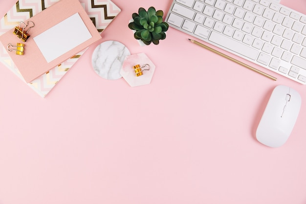 Pink office desk table workspace with a office supplies Premium Photo
