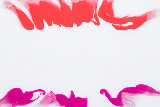 Pink and orange color paint splash isolated over white background Free Photo