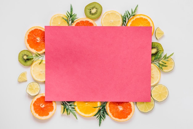 Pink paper of delicious sliced fruits Free Photo