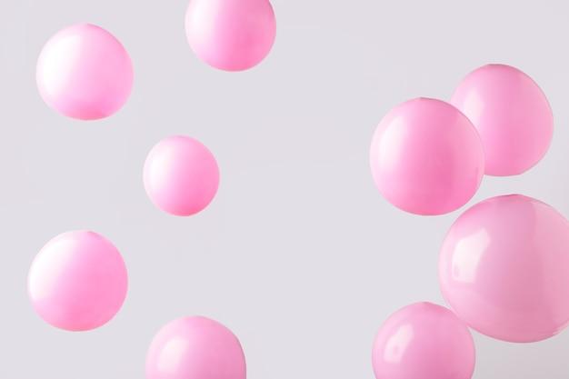 회색 바탕에 핑크 파스텔 Baloons입니다. 미니멀리즘. 평면도 프리미엄 사진