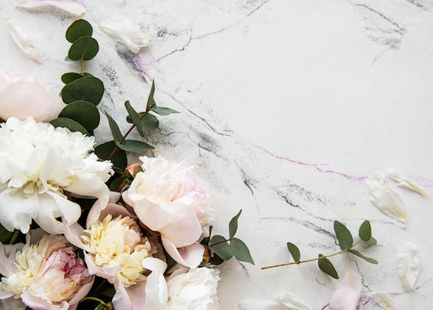 Pink peonies on a marble background Premium Photo