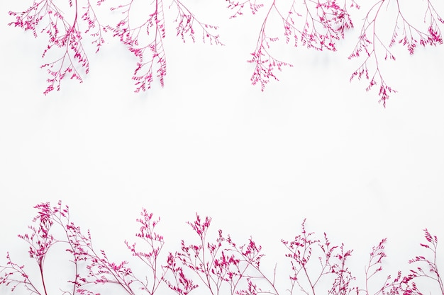 Pink plant branches scattered on table Free Photo