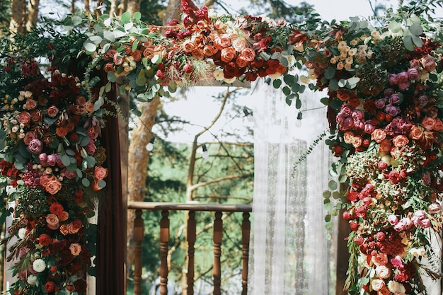 Pink and red spearworts decorated wedding altar Free Photo