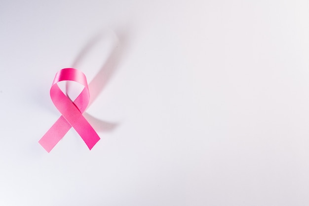 Pink ribbon cancer sign on white Free Photo