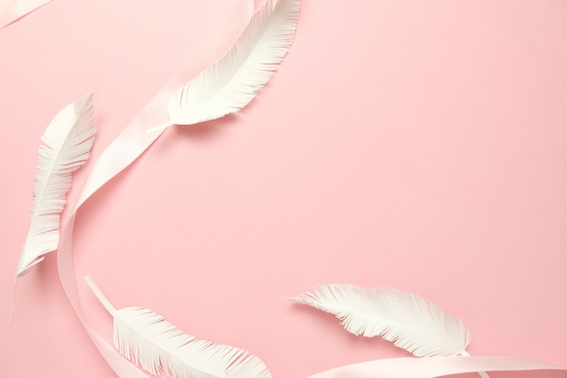 Pink ribbon in the shape pink background Premium Photo