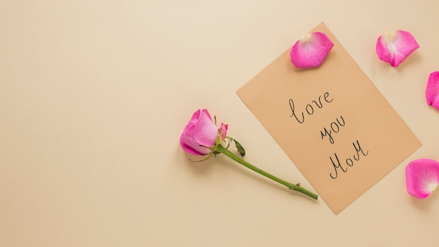 Pink rose flower with love you mom inscription Free Photo