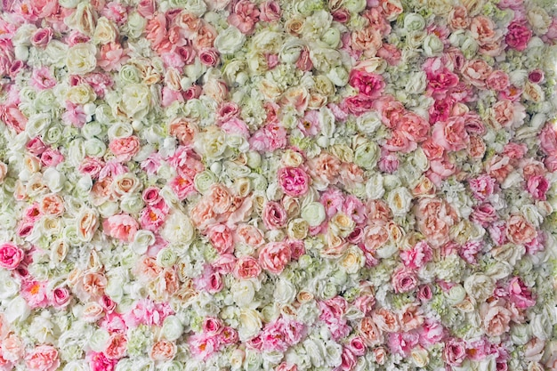 Pink roses, hydrangeas and peonies twined side by side Free Photo
