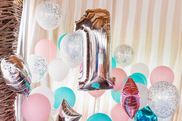 Pink, silver and blue inflatable balloons on ribbons Premium Photo