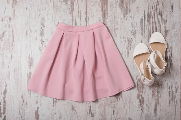 Pink skirt and white shoes. top view Premium Photo