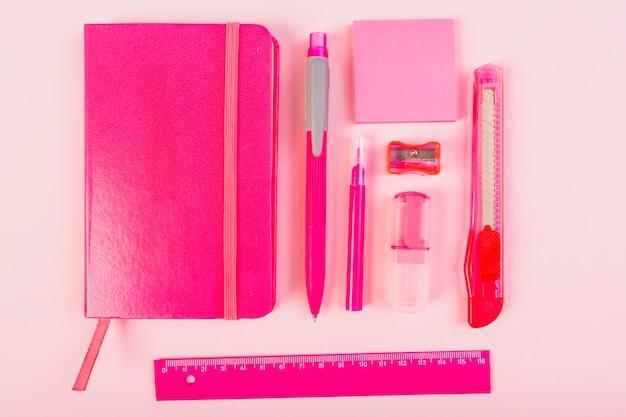 Pink stationery on desk Free Photo