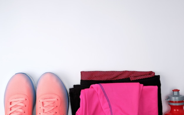 Pink textile shoes and other items for fitness Premium Photo