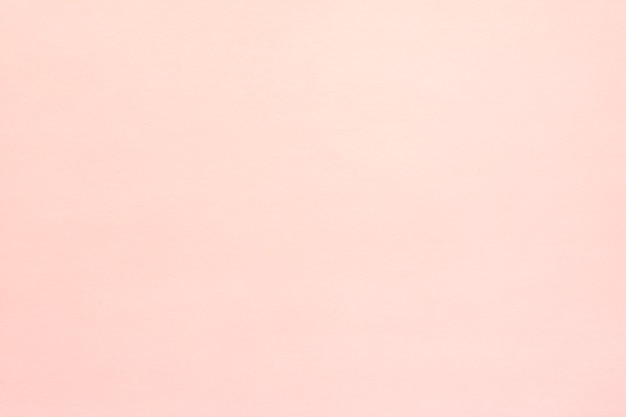 Pink textured stucco background Free Photo