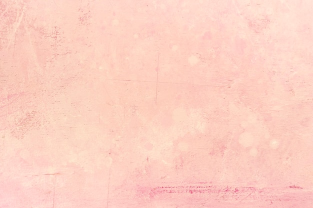 Pink textured stucco wall background Free Photo