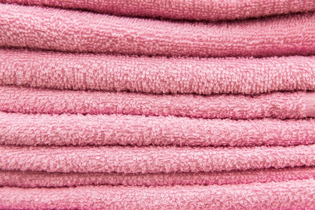 Pink towels in the hotel. texture of towels Premium Photo