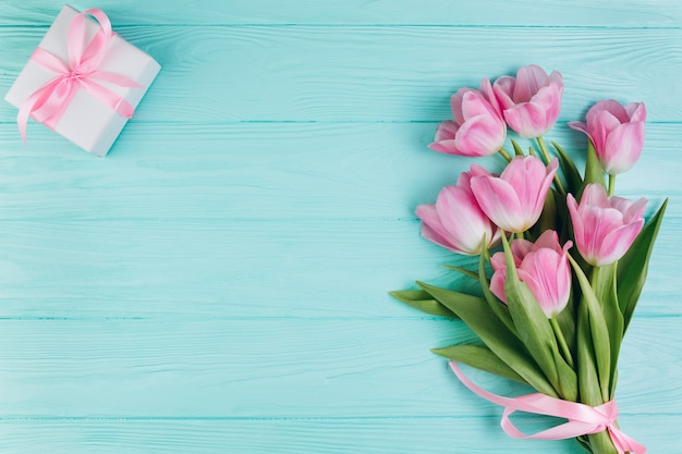 Pink Tulips And Gift On Blue Wooden Background Photo