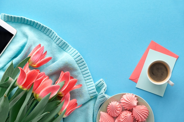 Pink tulips on mint colored cotton sweater and greeting cards Premium Photo