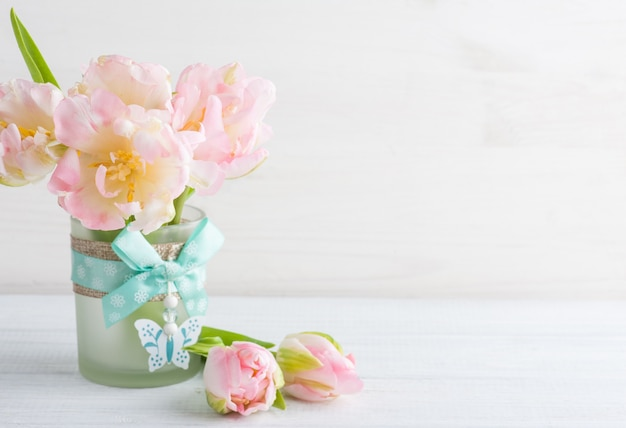 Pink tulips on a white wooden background Premium Photo