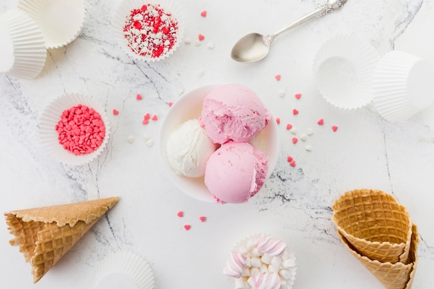 Pink and white ice cream in bowl Free Photo