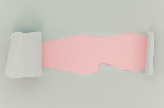 Pink and white torn paper surface Free Photo