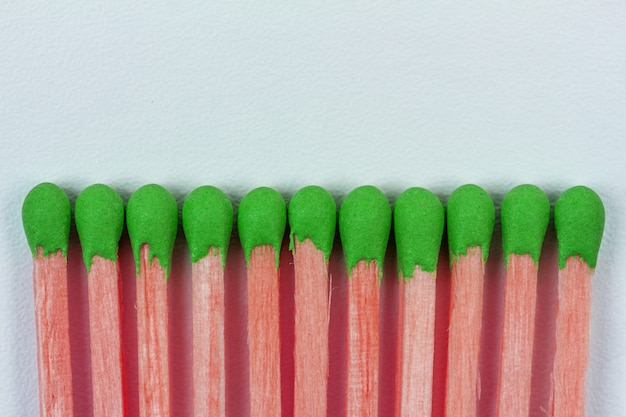 Pink wooden matches with green sulphur on grey Premium Photo