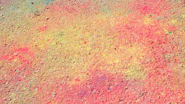 Pink and yellow holi color on ground Free Photo