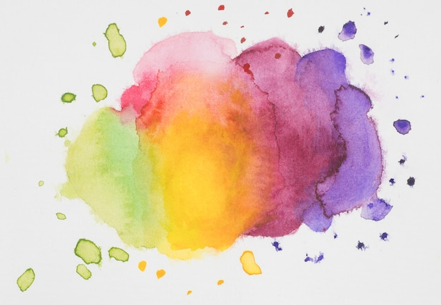 Pink, yellow, violet and green mix of paints on white paper Free Photo