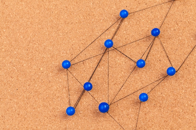 Pins connected creating a network Premium Photo