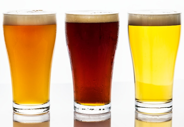 Pints of draught beer macro photography Free Photo