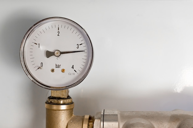 Pipefitter installing system of heating. manometer. warm floor system Premium Photo