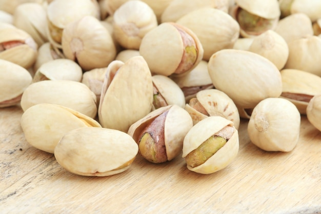 Pistachio nut on wood background. Premium Photo