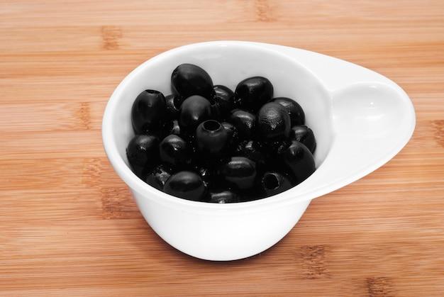 Pitted black olives Premium Photo