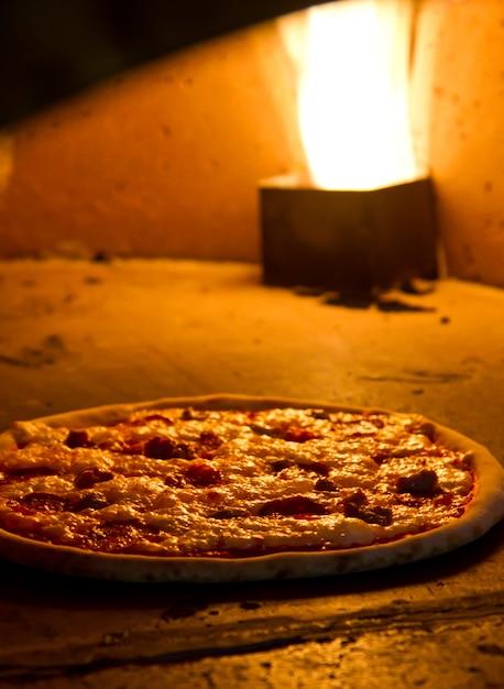 Pizza baking in the oven Premium Photo
