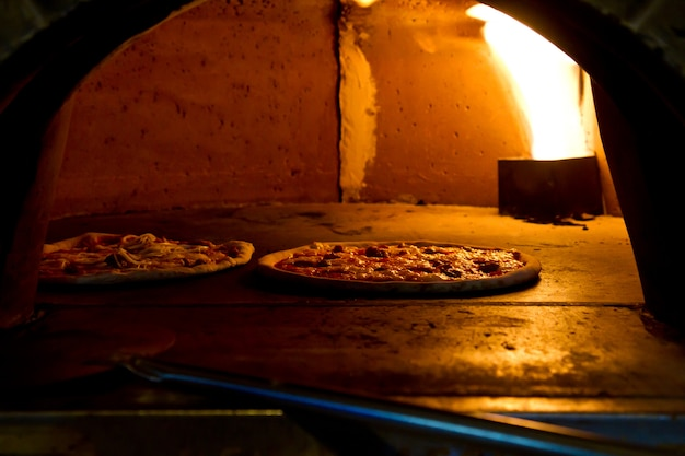 Pizza baking in the oven Premium Photo